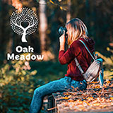 Oak Meadow for Homeschooling - Girl taking photo on a fall day