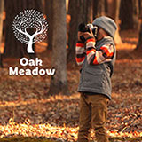 Oak Meadow for Homeschooling - Boy looking through binoculars