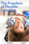 Young child lying with head hanging upside down and text The Freedom of Flexible Learning - TheHomeSchoolMom
