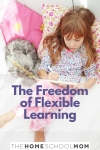 child lying on a bed coloring in a book next to a cat with text The Freedom of Flexible Learning - TheHOmeSchoolMom